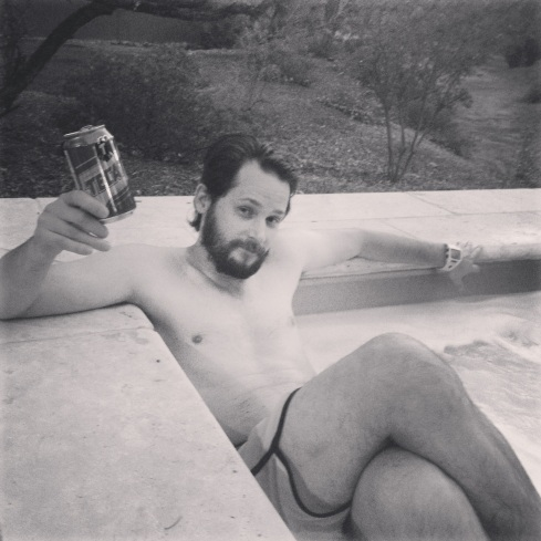 bri guy in a hot tub with his tecate